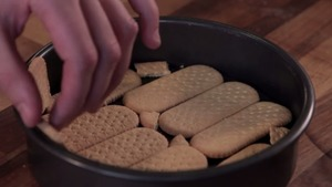 line the tin with biscuits